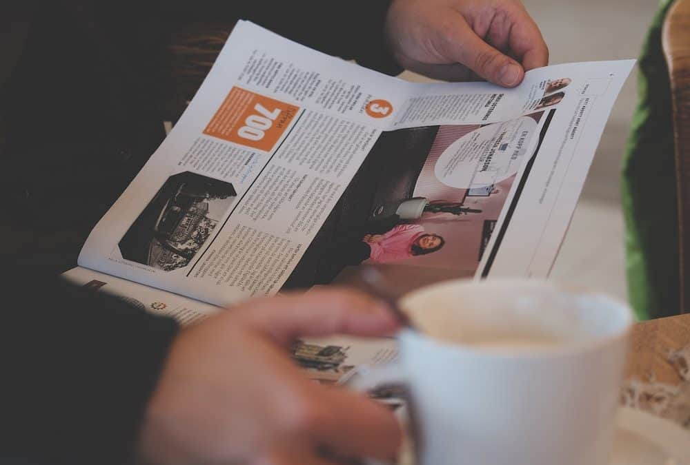 newspaper with cup of coffee