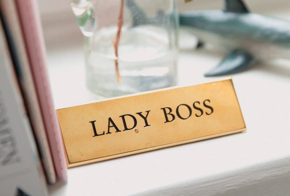 name plate for desk that reads lady boss on shelf