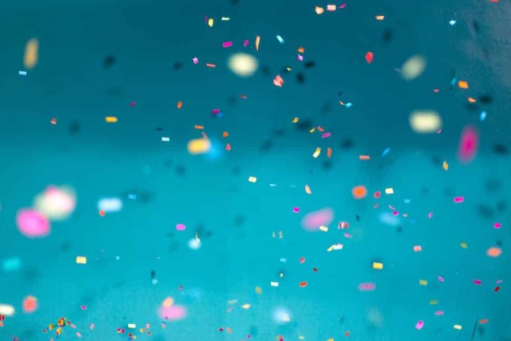 celebratory confetti on blue background