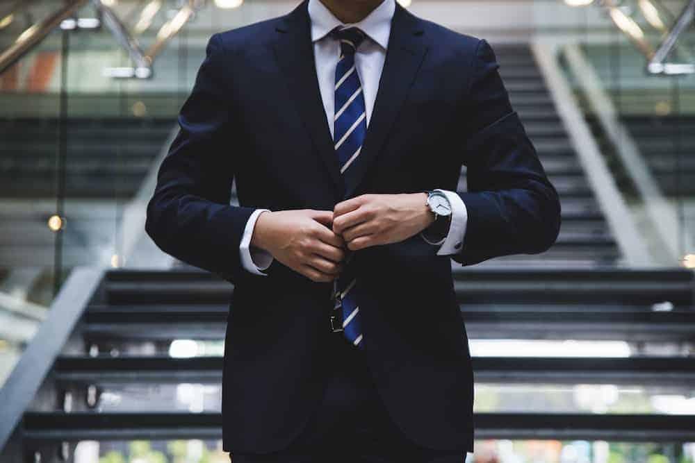 torso shot of man in suit going into job interview
