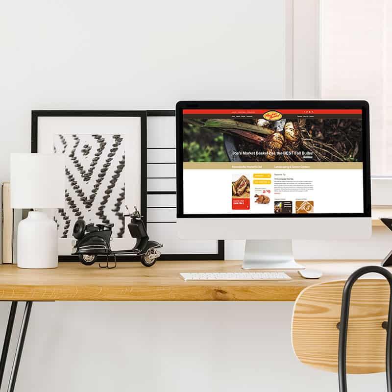 Joe's Market Basket website pulled up on computer on home office desk