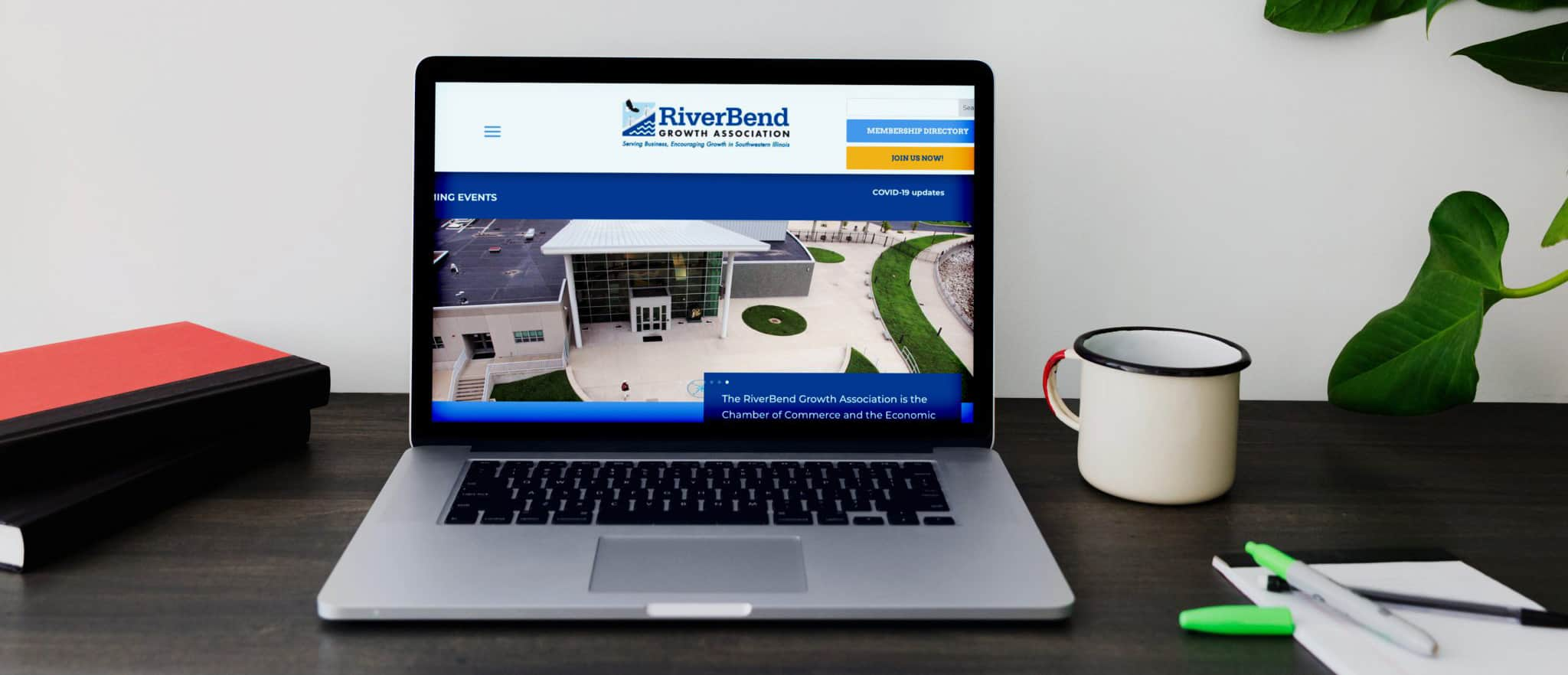 Riverbend Growth Association website pulled up on a laptop