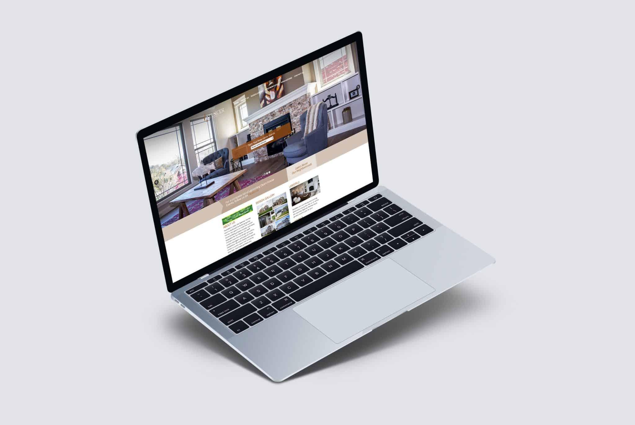 Spencer Homes website pulled up on a laptop