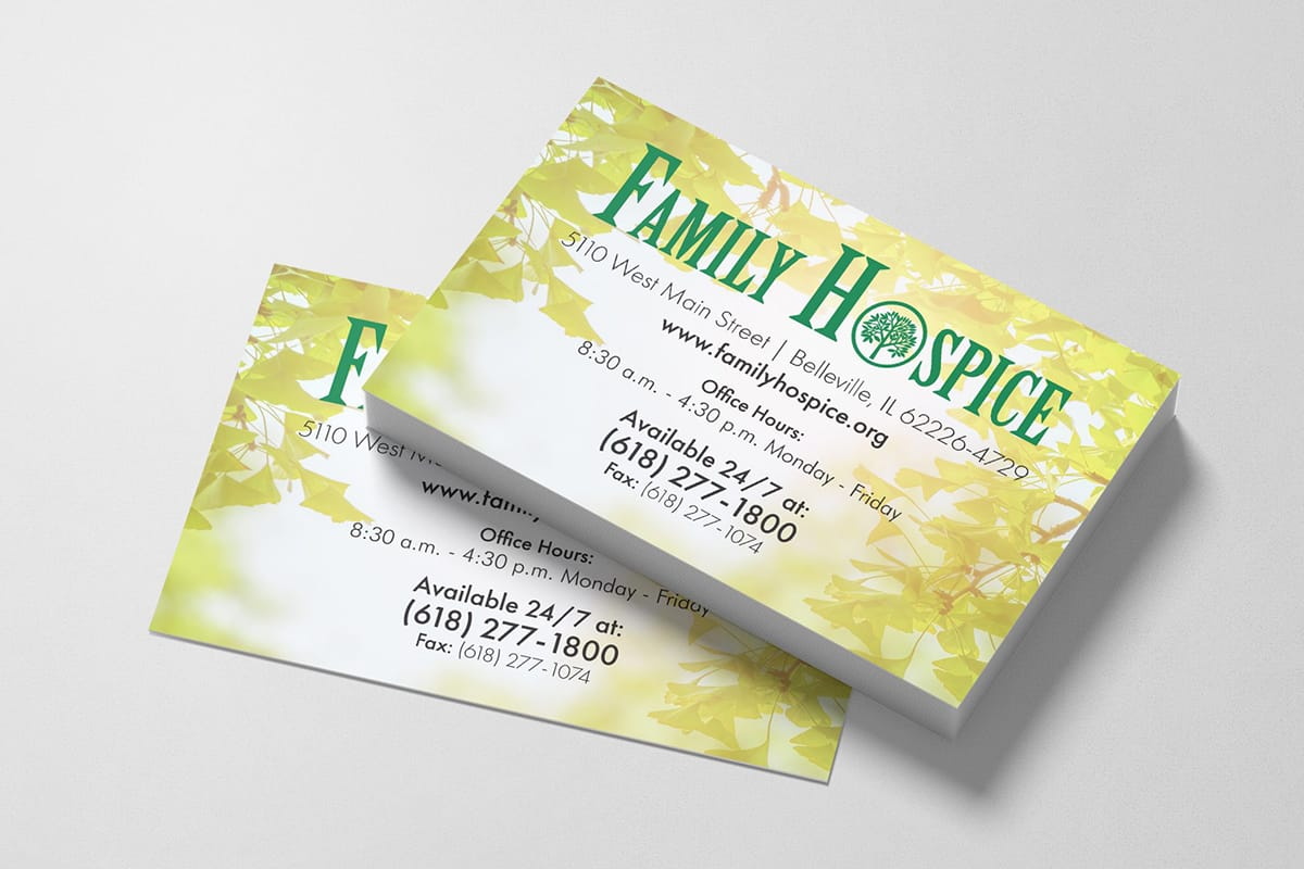 Family Hospice Business cards in a stack on a gray table