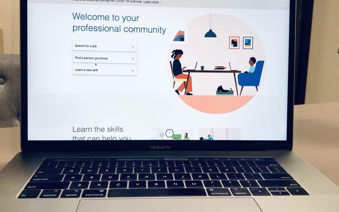 LinkedIn login screen on a laptop in an office