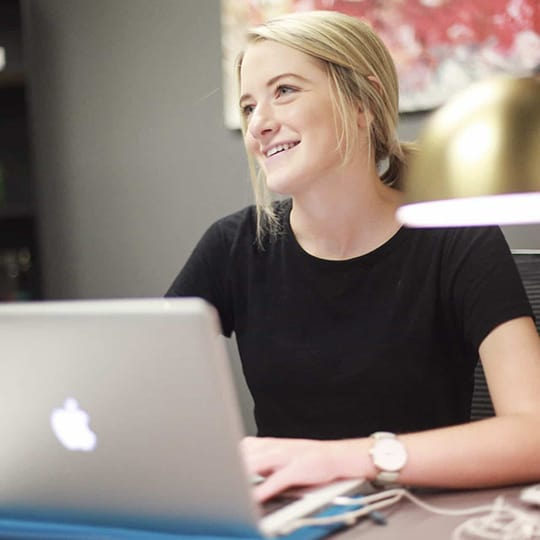 Account Executive marketing woman typing at her laptop